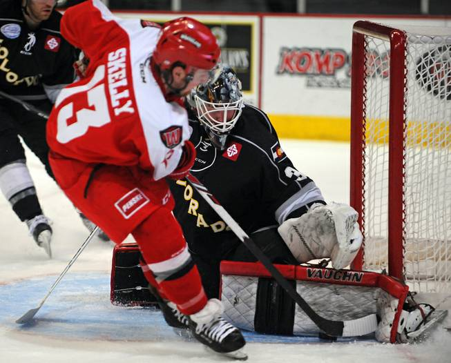 Colorado Eagles goaltender Dustin Butler stops Las Vegas Wranglers winger Shawn Skelly on a breakaway during the second period of play on Tuesday night.