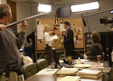 "Cast members of the ""Criminal Minds"" television series, A.J.Cook, center left, and Thomas Gibson, tape a scene Wednesday, Jan. 9, 2007, while on location in Long Beach, Calif. (AP Photo/Nick Ut)"