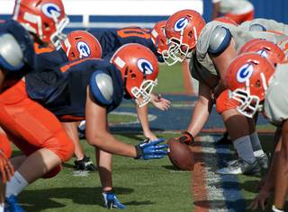 Bishop Gorman Gaels face off against each other on the line during a scrimmage at Fertitta Field on Monday afternoon.