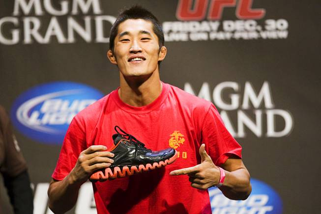 Welterweight fighter Dong Hyun Kim shows off his shoes during the UFC 141 weigh-in at the MGM Grand Garden Arena Thursday, Dec. 29, 2011.