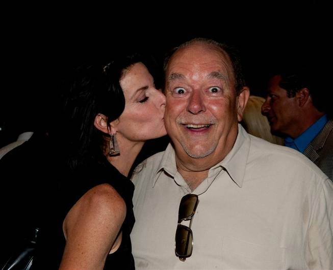 Robin Leach's 70th birthday dinner at the Cleveland Clinic Lou Ruvo Center for Brain Health on Sept. 10, 2011. Joan Severance gives Leach a smooch.