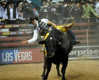 Brazil's Robson Palermo wins the third round of the 2009 Professional Bull Riders World Finals at Thomas & Mack Center on Nov. 1, 2009, atop Black Pearl.