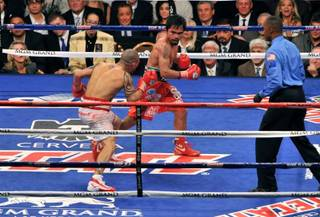 Manny Pacquiao and Miguel Cotto in the final seconds of their fight, and Manny celebrating his victory, at MGM Grand Garden Arena on Nov. 14, 2009.