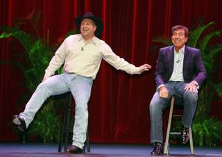 Entertainer Garth Brooks, left, and Wynn Resorts CEO Steve Wynn announce a deal during a news conference in the Encore Theater at the Wynn Las Vegas hotel-casino Thursday, Oct. 15, 2009. The arrangement will bring Brooks out of retirement for a series of special performances in the theater.