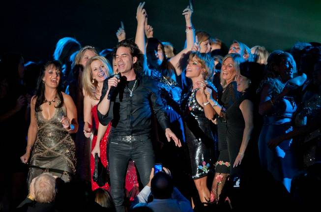 Train, with fans onstage, performs during the Andre Agassi Grand Slam for Children benefit gala at Wynn Las Vegas on Oct. 29, 2011.