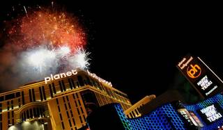 Fireworks erupt over Planet Hollywood and the Strip on New Year's Eve 2009.