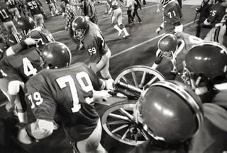 Football team with Fremont Cannon circa 1974. (UNLV Photo Services)