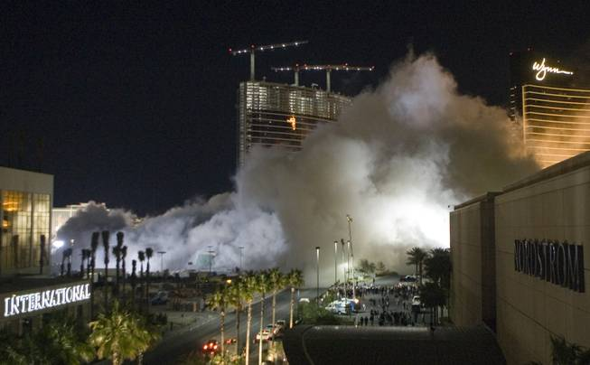 Dust from the implosion of the New Frontier hotel tower drifts to the south in Las Vegas, Nevada November 13, 2007. The casino on The Las Vegas Strip was purchased by Elad properties, an Israeli-owned real estate investment group, for more than U.S. $1.2 billion in May 2007. Elad Group, which also owns the Plaza hotel in New York, and the IDB Group are expected to build a Plaza-themed, multi-billion dollar megaresort on the site.