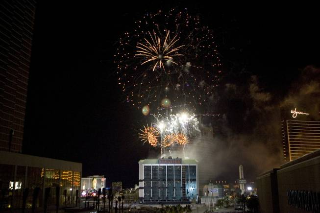 A fireworks show explodes over the New Frontier hotel tower before it is imploded in Las Vegas, Nevada November 13, 2007. The casino on The Las Vegas Strip was purchased by Elad properties, an Israeli-owned real estate investment group, for more than U.S. $1.2 billion in May 2007. Elad Group, which also owns the Plaza hotel in New York, and the IDB Group are expected to build a multi-billion dollar Plaza-themed megaresort themed on the site.