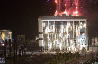 Fireworks explode before the implosion of the New Frontier hotel tower in Las Vegas, Nevada November 13, 2007. The casino on The Las Vegas Strip was purchased by Elad properties, an Israeli-owned real estate investment group, for more than U.S. $1.2 billion in May 2007. Elad Group, which also owns the Plaza hotel in New York, and the IDB Group are expected to build a Plaza-themed, multi-billion dollar megaresort on the site.