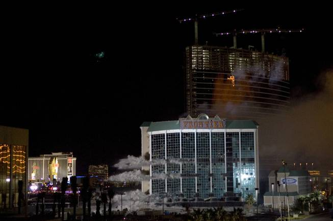 Charges go off inside the New Frontier hotel tower is imploded in Las Vegas, Nevada November 13, 2007. The casino on The Las Vegas Strip was purchased by Elad properties, an Israeli-owned real estate investment group, for more than U.S. $1.2 billion in May 2007. Elad Group, which also owns the Plaza hotel in New York, and the IDB Group are expected to build a multi-billion dollar Plaza-themed megaresort on the site.