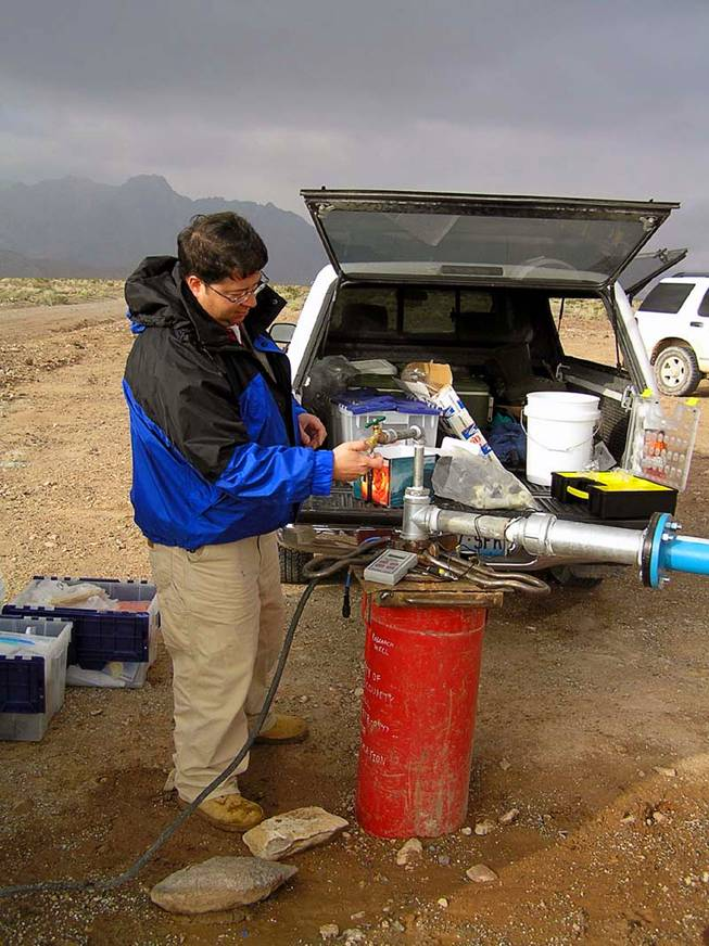 Duane Moser, a microbial and molecular ecologist at the Desert Research Institute, takes water samples from a well in California near Death Valley in 2007. Moser is part of a team of researchers that just received a $6.6 million NASA grant to explore life underground. The site will be one of the main land-based places of interest for the new study.