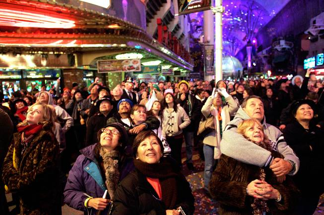 People watch the fireworks over the Plaza Hotel on New Year's Day in downtown Las Vegas.