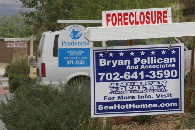Foreclosed and for sale homes line the 9800 block of Fast Elk Street in northwest  Las Vegas.