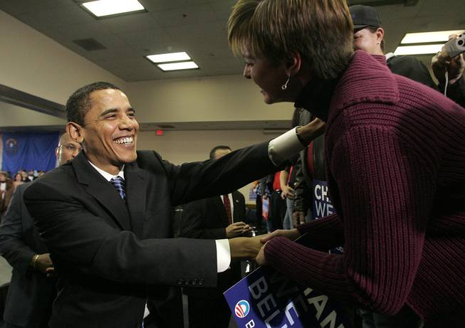 Sen. Barack Obama greets supporter Renee Wood after holding a town hall meeting in Henderson. Obama and his two major rivals are crisscrossing Nevada as the state counts down to its caucuses.