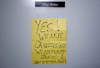 A sign hangs on the outside door of Culinary Union Local 226 political director Pilar Weiss after a caucus day rally and informational meeting at the Culinary Union Local 226 headquarters in Las Vegas early in the morning Saturday, January 19, 2008.
