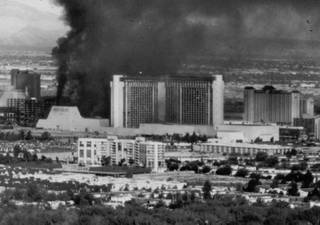 Smoke billows out of the MGM Grand as the hotel is engulfed in flames on Nov. 21, 1980. Faulty wiring in an unused delicatessen is the cause of the worst disaster in Nevada history and the country's second-worst hotel fire.