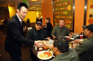 Master magician Lance Burton greets Monte Carlo employees Jose Ruiyes, Gelder Garcia, Tommy Hanesana, Jorge Munoz and Fidel Ayala during their lunch break. Employees are hard at work making repairs after an exterior fire forced the property to temporarily close last Friday.
