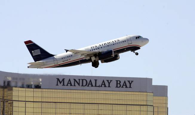 A US Airways passenger jet takes off from McCarran International Airport.