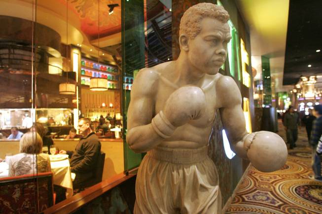 The marble statue of boxing legend Joe Louis stands outside the Race and Sports Book at Caesars Palace.