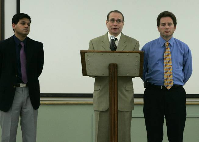 Endoscopy Center of Southern Nevada doctors Sanjay Nayyar, left, and Clifford Carrol flank fellow doctor Eladio Carrera as he reads a statement  during a news conference at the health district Wednesday, February 27, 2008. The Southern Nevada Health District is notifying about 40,000 former patients of the Endoscopy Center of Southern Nevada that they may have been exposed to hepatitis C.