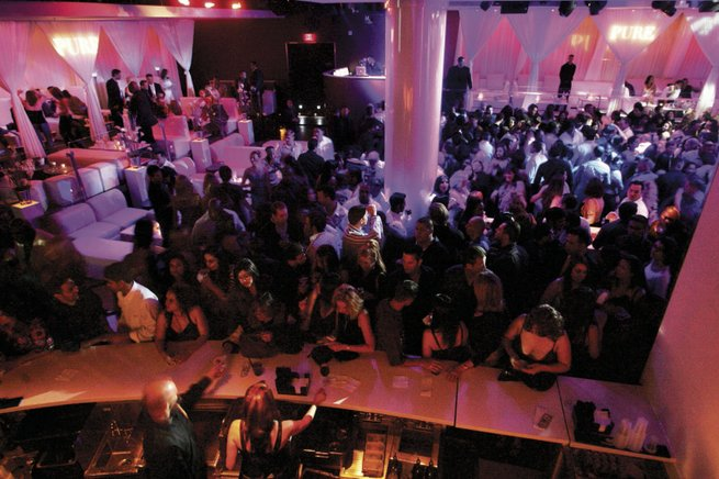 Patrons step up to the bar and fill the dance floor at Pure in Caesars Palace.