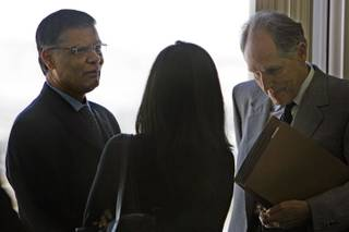 Dr. Dipak Desai, left, the majority owner of the Endoscopy Center of Southern Nevada, talks with attorney Richard Wright, right, and an unidentified woman before a hearing at Las Vegas City Hall March 3, 2008. Attorneys representing the Endoscopy Center of Southern Nevada appealed to overturn the city's suspension of the center's business license but the appeal was denied.