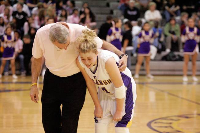 "La Rocque comforts his daughter Lindy La Rocque during the coach's last home game. He says he ""never dreamed it would be so much fun"" coaching Lindy and his other daughter, Ally, born 14 months apart."