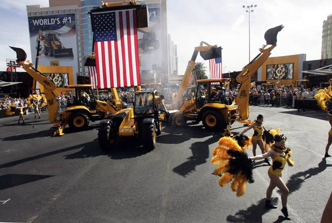 The Dancing Diggers perform Tuesday at the sprawling ConExpo convention outside the Las Vegas Convention Center.