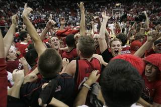 UNLV Rebels and fans celebrate their 76-61 defeat of BYU in the Mountain West Conference championship game Saturday, March 15, 2008 at the Thomas & Mack Center.