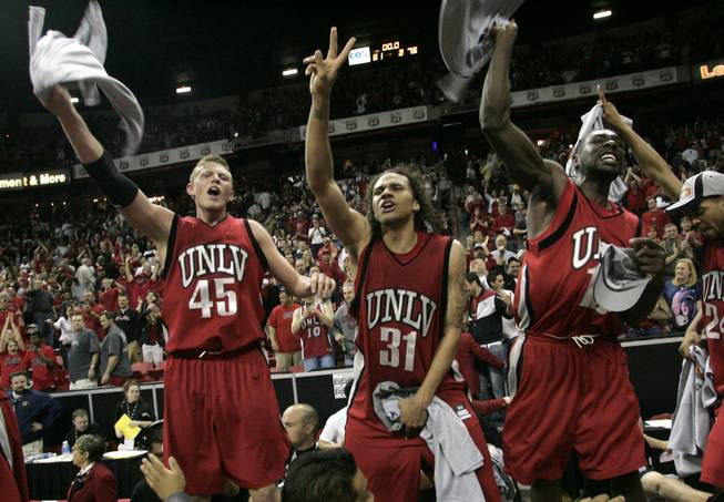 From left, UNLV's Joe Darger, Curtis Terry and Corey Bailey celebrate their 76-61 defeat of BYU in the Mountain West Conference championship game Saturday, March 15, 2008 at the Thomas & Mack Center.