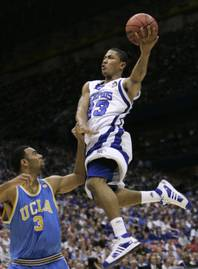 This April 5, 2008 file photo shows Memphis' Derrick Rose, right, shooting over UCLA's Josh Shipp (3) during the first half of a semifinal at the Final Four basketball tournament in San Antonio.