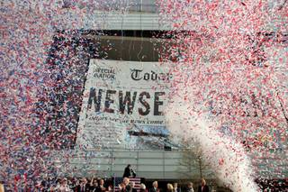 Confetti flies as the Newseum officially opens on Pennsylvania Avenue NW in Washington D.C. Friday, April 11, 2008.