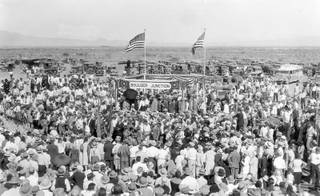 A large crowd celebrates the completion of the railroad at Boulder Junction (near the Hoover Dam) on Sept. 17, 1930. Work on the dam began in 1931. Dam workers were forced to stay in tents because Boulder City had not been completely built. That, combined with poor working conditions, led to a strike in 1931.  The strike was soon quelled, and by 1932 Boulder City was established.
