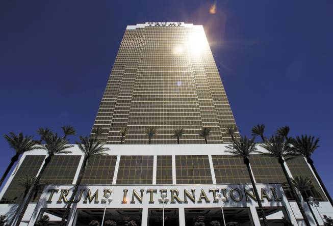 Trump's latest luxury property rises 64 stories over the Strip. A restaurant in the 1,282-suite tower is simply named DJT, his initials. Developers, real estate agents, politicians and beauty queens helped the Donald fete the opening.