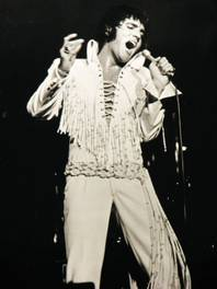 Elvis Presley wails into the microphone during a 1970 performance at the International Hotel.