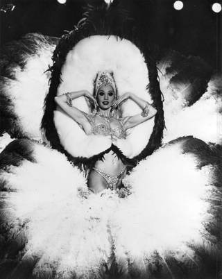 A Folies Bergere performer poses for the camera during a 1977 performance at the Tropicana's Tiffany theater.