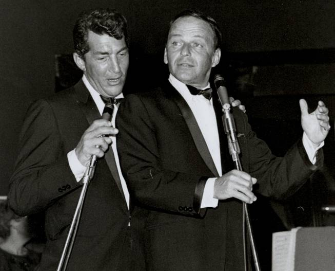 "Frank Sinatra and Dean Martin sing a duet together during a 1960s performance in the Sands' Copa Room. The Rat Pack was born when Sinatra joined Martin onstage to sing ""Sleep Warm"" at the Sands on Jan. 20, 1960."