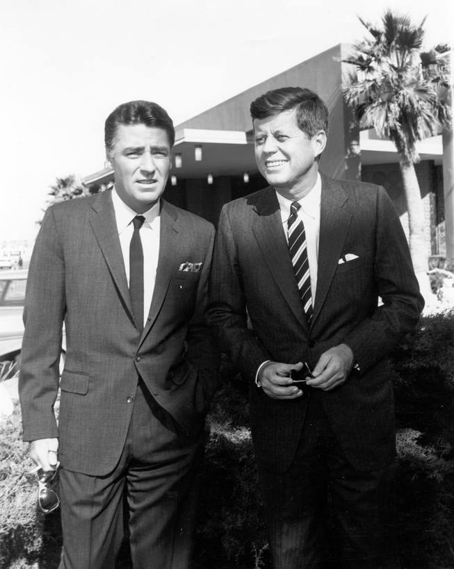 Rat Pack singer Peter Lawford, left, poses with then presidential candidate, John F. Kennedy.  Lawford was married to Kennedy's sister, Patricia Kennedy Lawford, and, along with the Rat Pack, campaigned heavily for Kennedy in 1960.