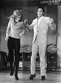 "Ann-Margret and Elvis Presley dance together for the filming of MGM's ""Viva Las Vegas."" Their on-screen chemistry translated to off-screen romance as the two were involved in a highly publicized affair."