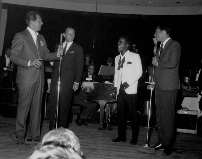 Sammy Davis Jr. roars with laughter as he and fellow Rat Pack members Dean Martin, Frank Sinatra and Joey Bishop perform together at the Sands' Copa Room during the 1960s.