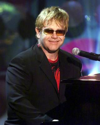 "Sir Elton John performs ""Your Song"" during the Radio Music Awards at the Aladdin Theatre for the Performing Arts on Oct. 26, 2001. John also received the Legend Award during the show which was broadcast live on the ABC network."