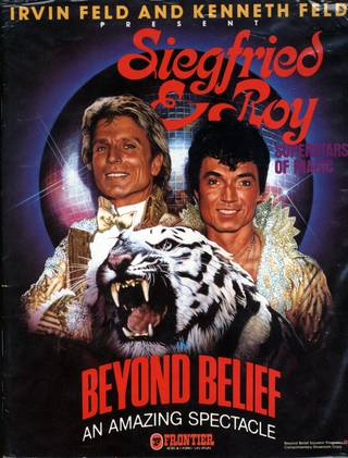"Siegfried & Roy are pictured on the cover of a souvenir program from their show ""Beyond Belief"" at the Frontier Hotel. Beyond Belief was the first show that treated the duo as more than just a specialty act, and it marked the beginning of the duo's rise to superstardom."