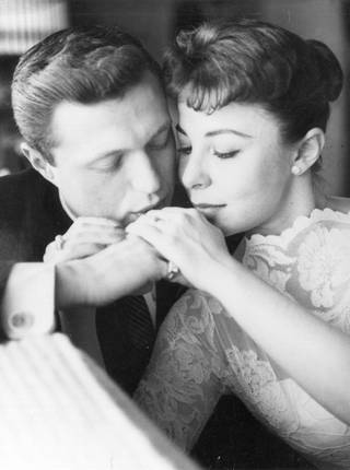 Performers Steve Lawrence and Eydie Gorme share an intimate moment at their Las Vegas wedding, 1957. The duo were famous for their 10-year run as headliners at Caesars Palace, as well as performances at the Sands and Desert Inn.