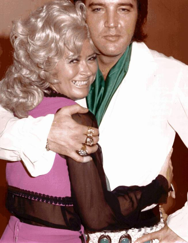 Janie Steele hugs Elvis Presley in this 1960s photo. Steele has retired after nearly 30 years at the Hilton, where she worked in photography and bookkeeping.