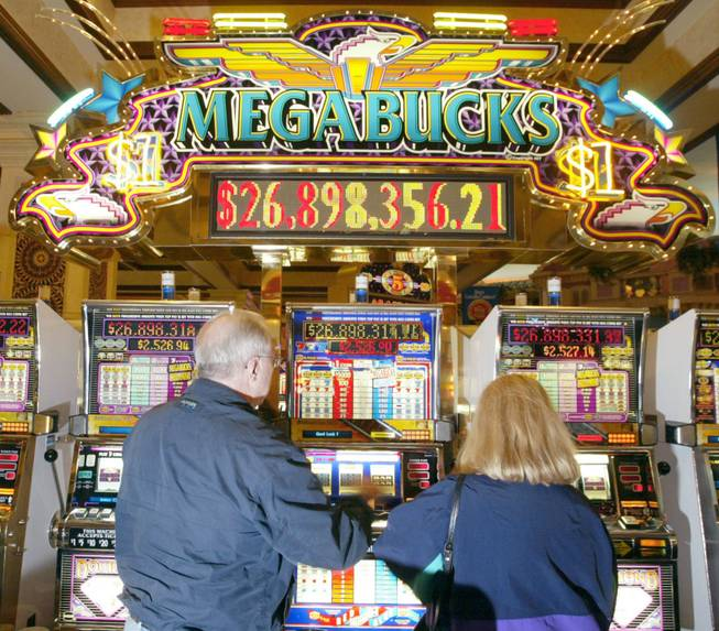 Dan Healy and his wife Margaret Healy try their hand at winning Megabucks at Sunset Station. Megabucks is a progressive dollar slot machine, which means that the more money people put in, the bigger the jackpot gets. Jackpots hit have ranged from $7 million to $39 million.