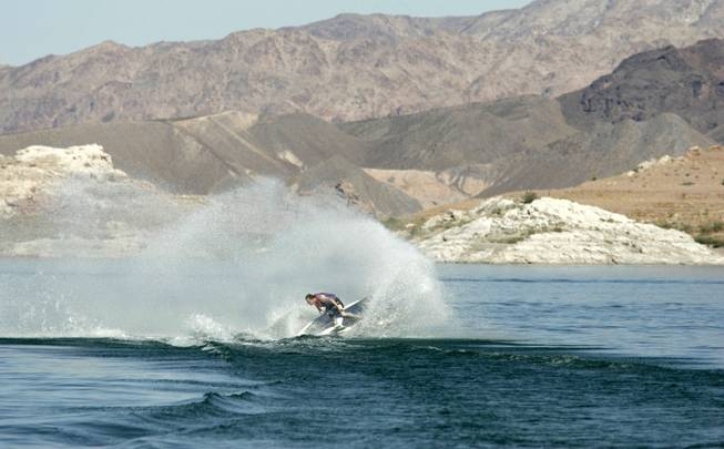 Despite declining water levels, Kris Verville still finds enough water to kick up with his jet ski at Lake Mead on Oct. 6, 2004. Lake Mead is currently over half full, and its water level dropped approximately 80 feet between 1999 and 2006.