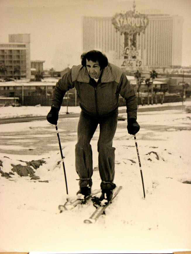 "Near the Strip, a skier enjoys one of the valley's few snows. A winter storm dumped 7.4 inches of snow on the valley floor on January 31, 1979.  The next day, during his show at the Aladdin Hotel, comedian Gabe Kaplan quipped ""Las Vegas has always been my favorite ski resort."""