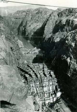 Boulder Dam's framework shown from the downstream side as its construction gets underway. The Hoover Dam project is awarded to Six Companies Inc. The chief executive of the company develops many of the techniques used to build the dam. Due to the furious pace the workers were subjected to, the project is finished two years ahead of schedule in 1935.