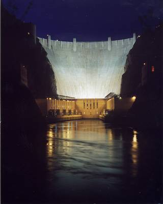 A tranquil view of Hoover Dam at night. Each year about 10 million people visit Hoover Dam. It's maintained by the U.S. Bureau of Reclamation and became a National Historic Landmark in 1985.
